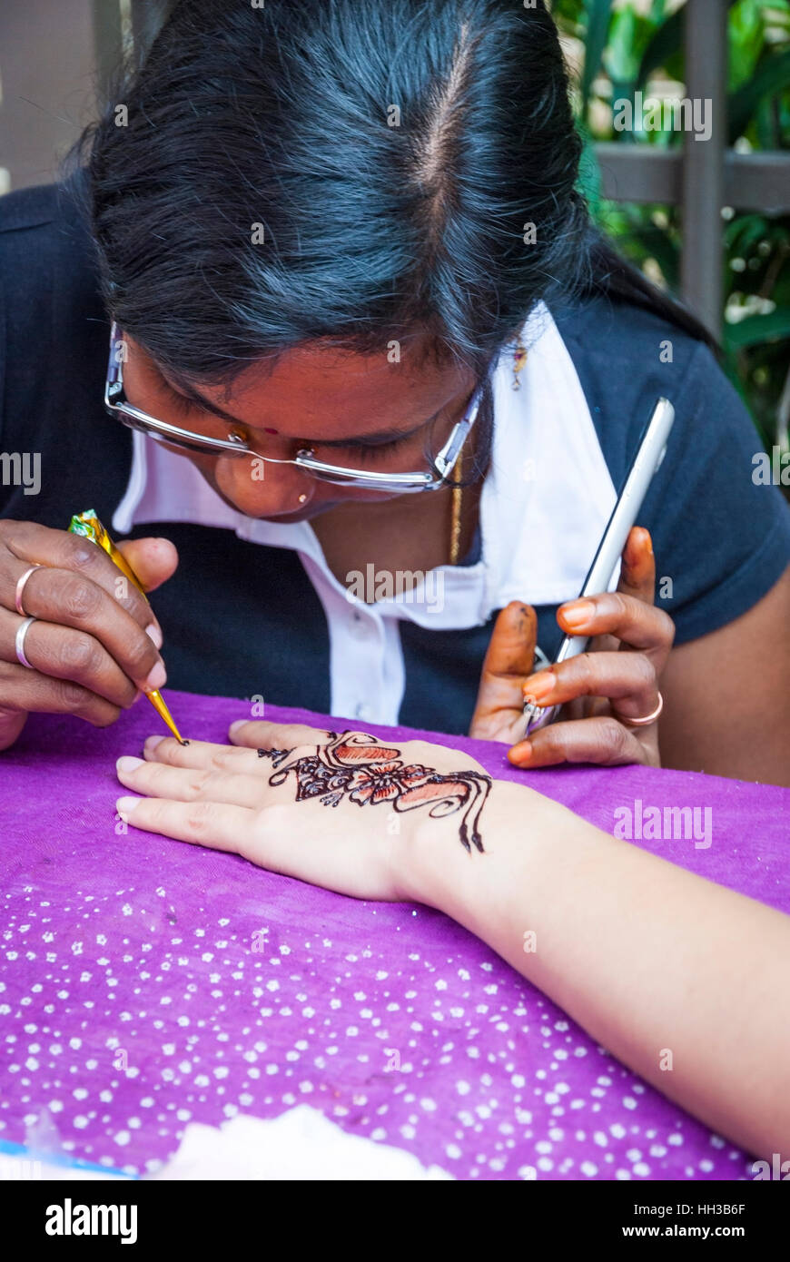 George Town Malaysia October 25 Woman Drawing A Henna Tattoo On