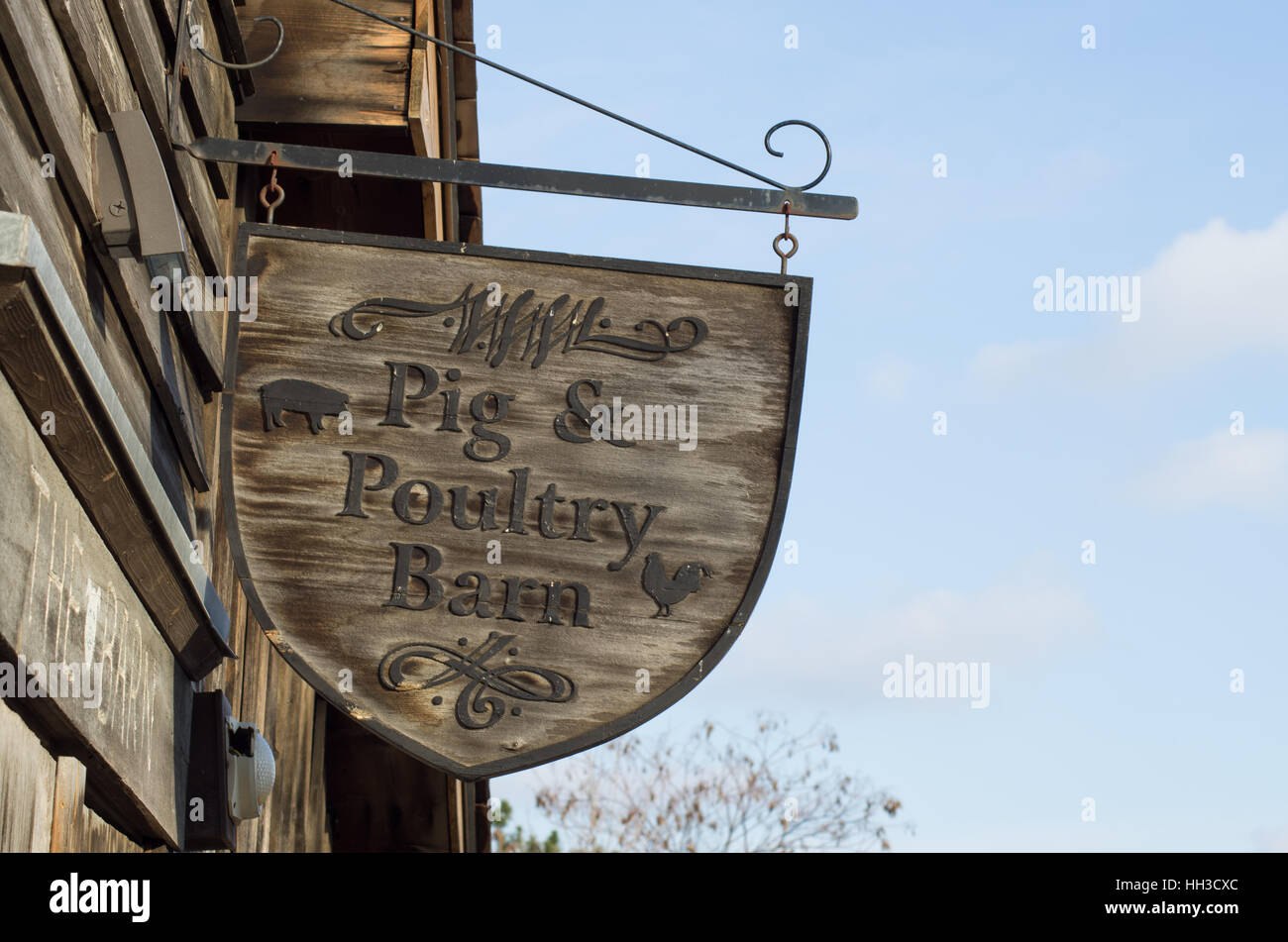 Wooden sign saying Pig & Poultry Barn - Stock Image
