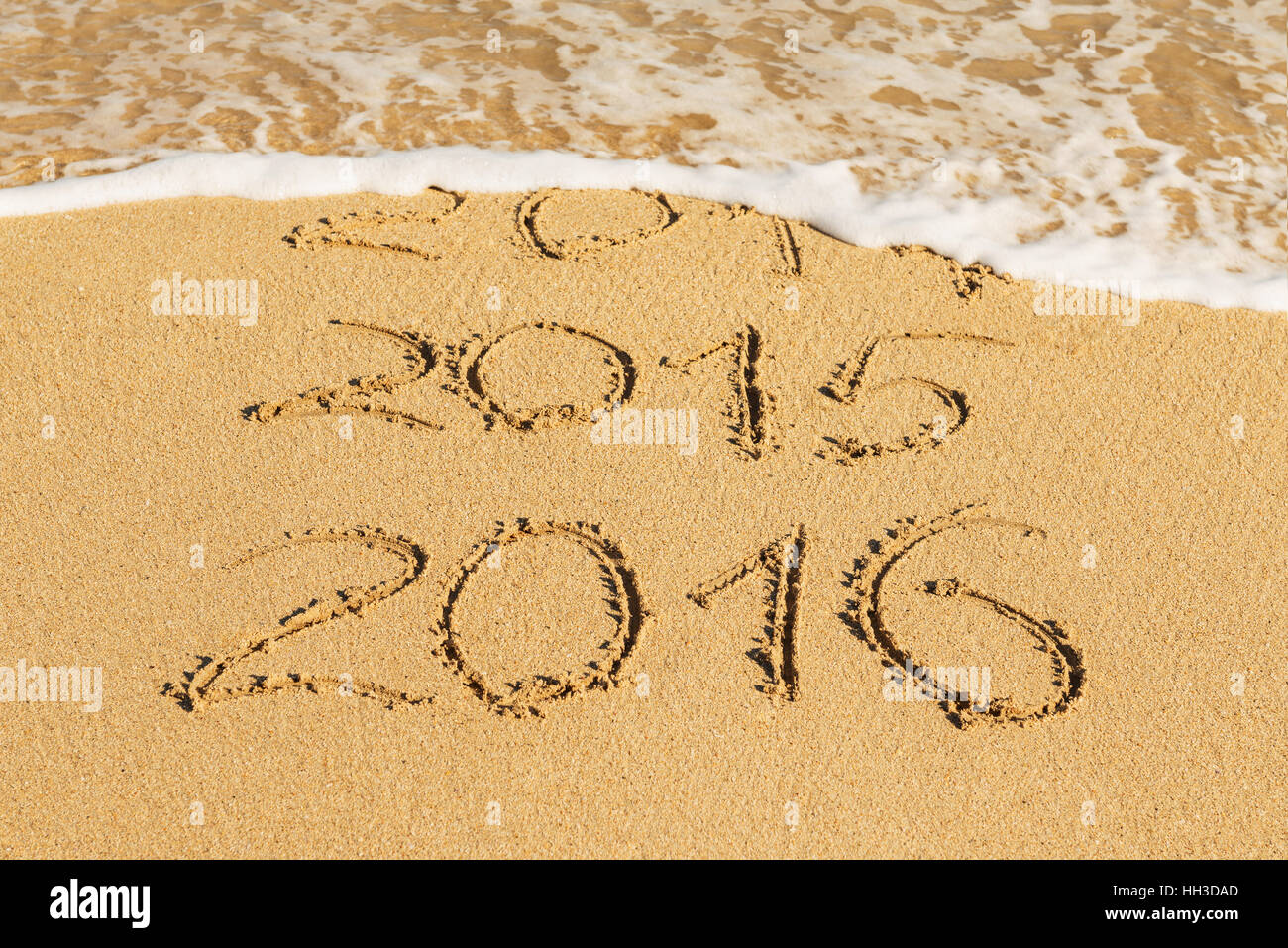 digits  2014,2015 and 2016 on the sand seashore - concept of new year and passing time - Stock Image