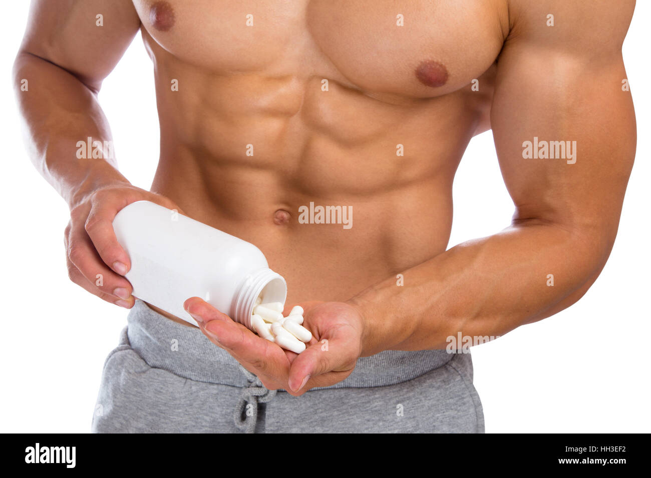 Doping anabolic pills abuse bodybuilder bodybuilding muscles strong muscular man body builder - Stock Image