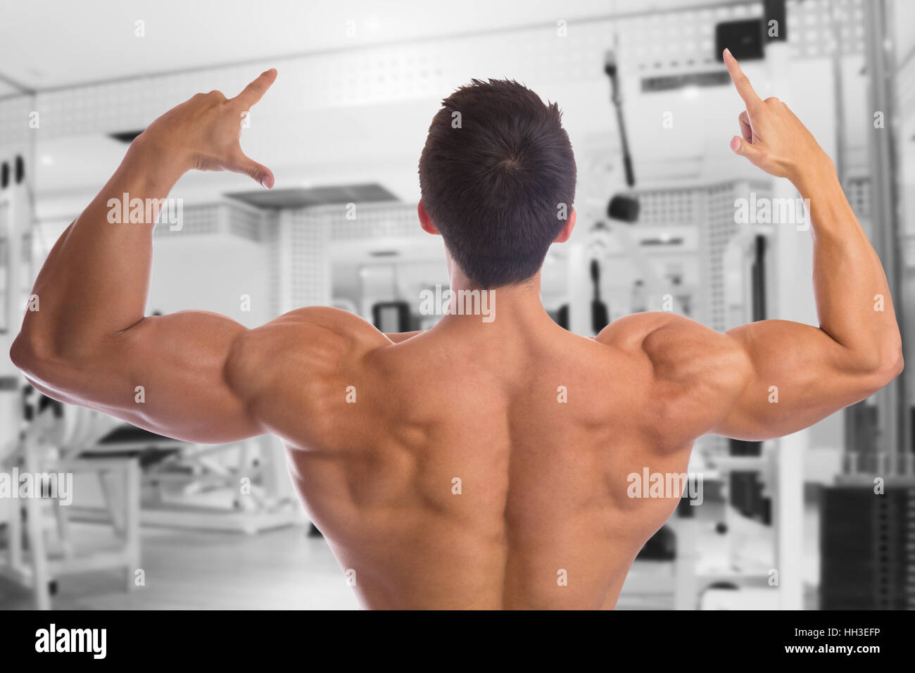 Bodybuilder bodybuilding muscles back gym strong muscular fitness studio - Stock Image