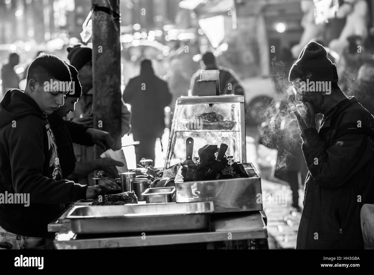 A street vendor sells food in market, old city Jerusalem, Israel, Middle East - Stock Image