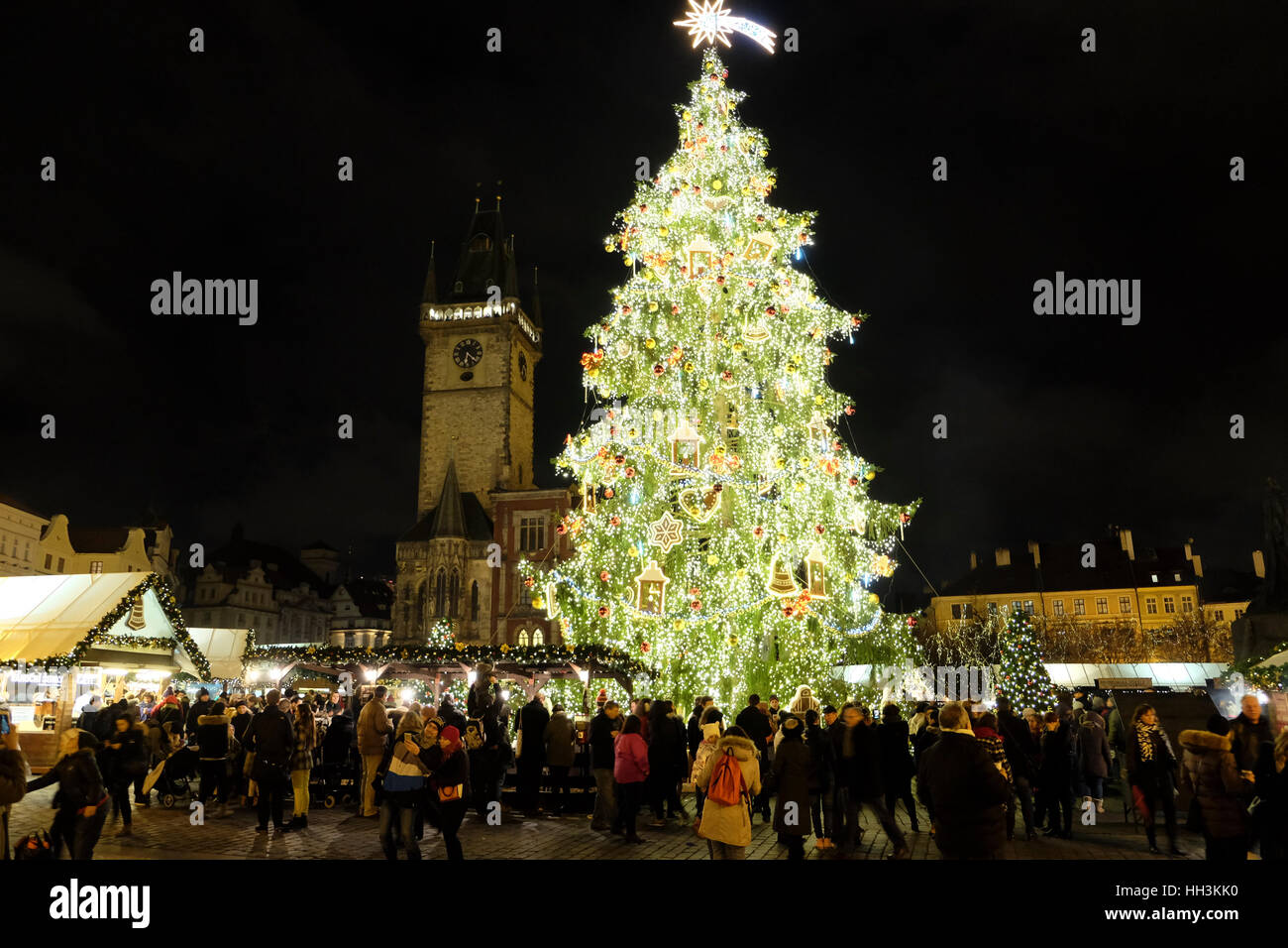 The old Town Square in Prague with Christmas tree and the clock tower in the background. - Stock Image