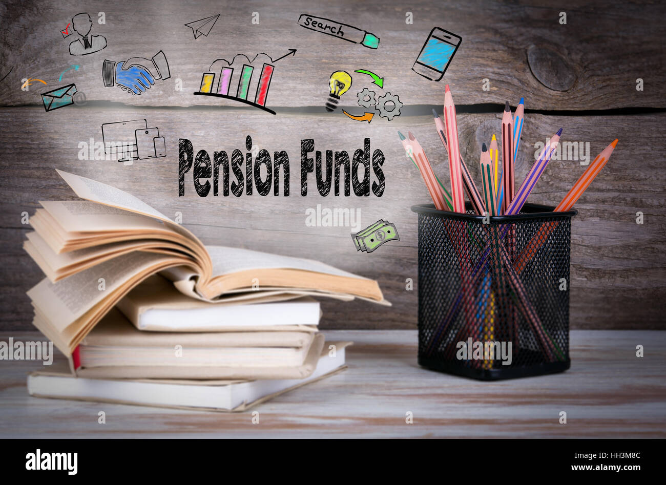 Pension Funds Concept. Stack of books and pencils on the wooden table. - Stock Image
