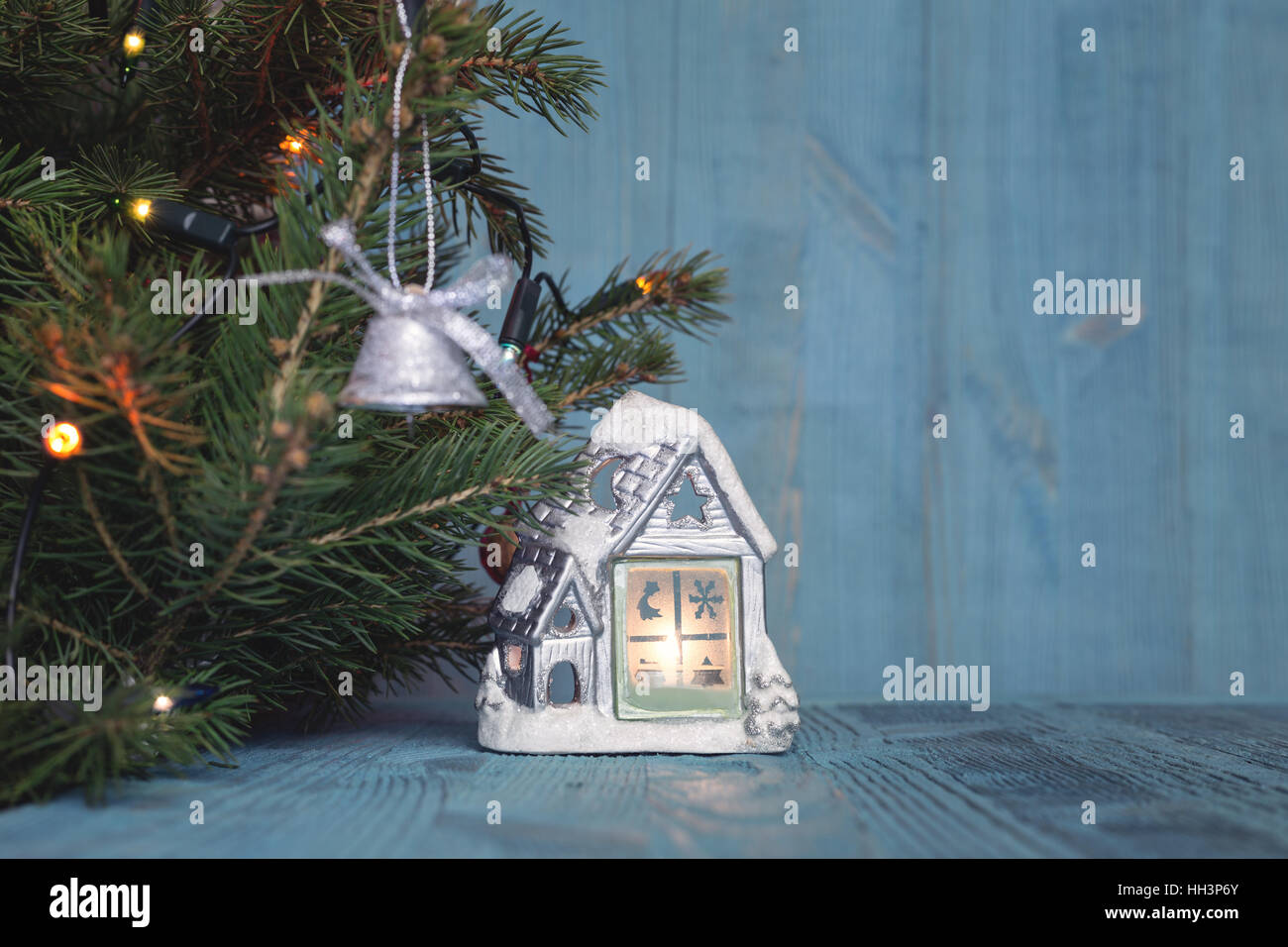 Christmas tree on a background of blue planks - Stock Image