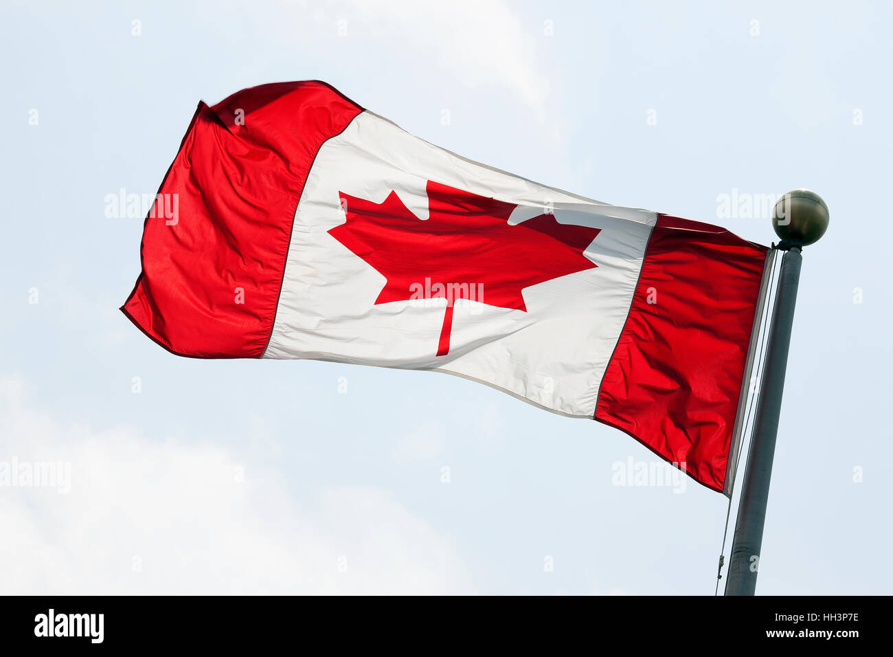 Canadian Flag on Flagpole Stock Photo