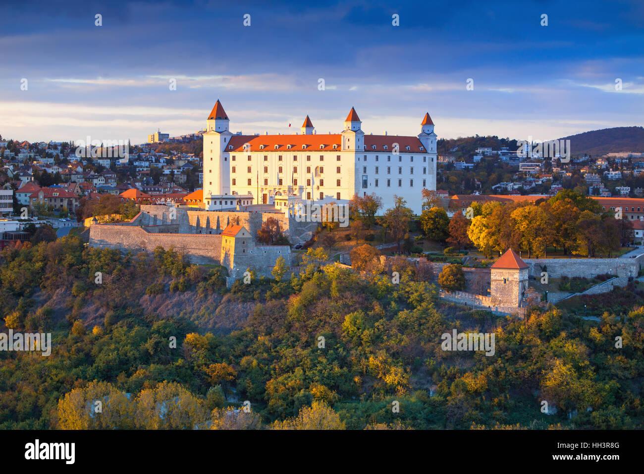 Bratislava castle over Danube river at sunset,Bratislava,Slovakia - Stock Image