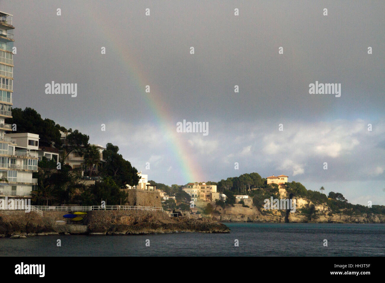 Rainbow over cloudy sky seascape Mallorca Spain - Stock Image