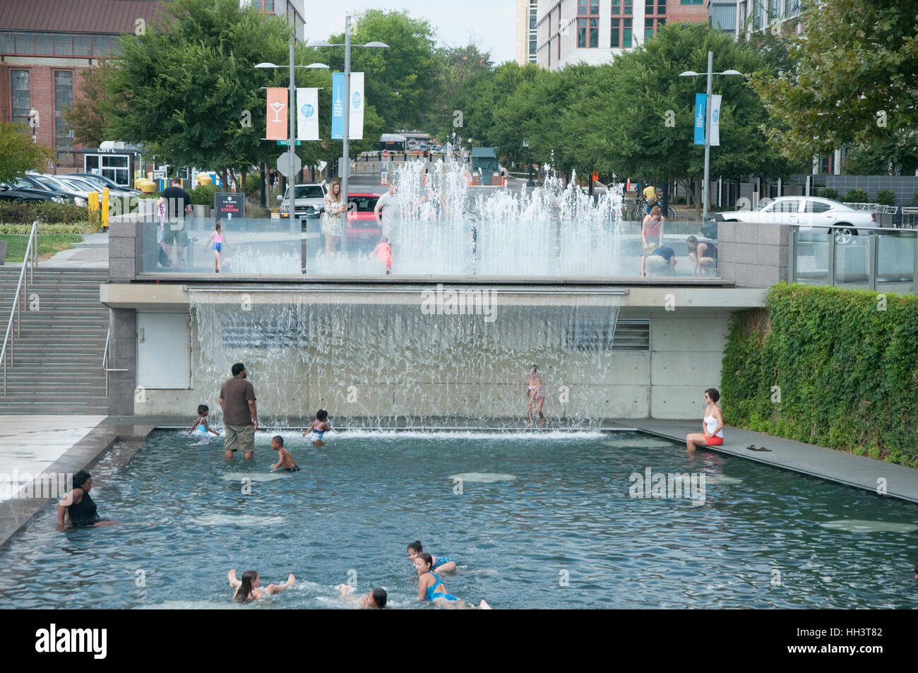 People are splashing in pool at Yards Park in the summer in Washington, DC Stock Photo