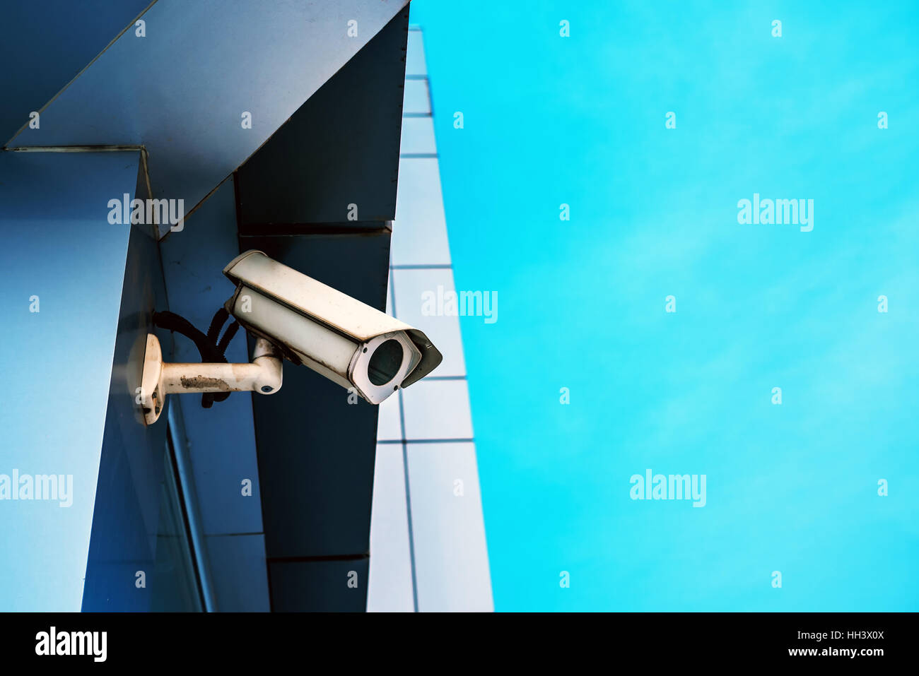 Surveillance camera on modern building for private property protection - Stock Image