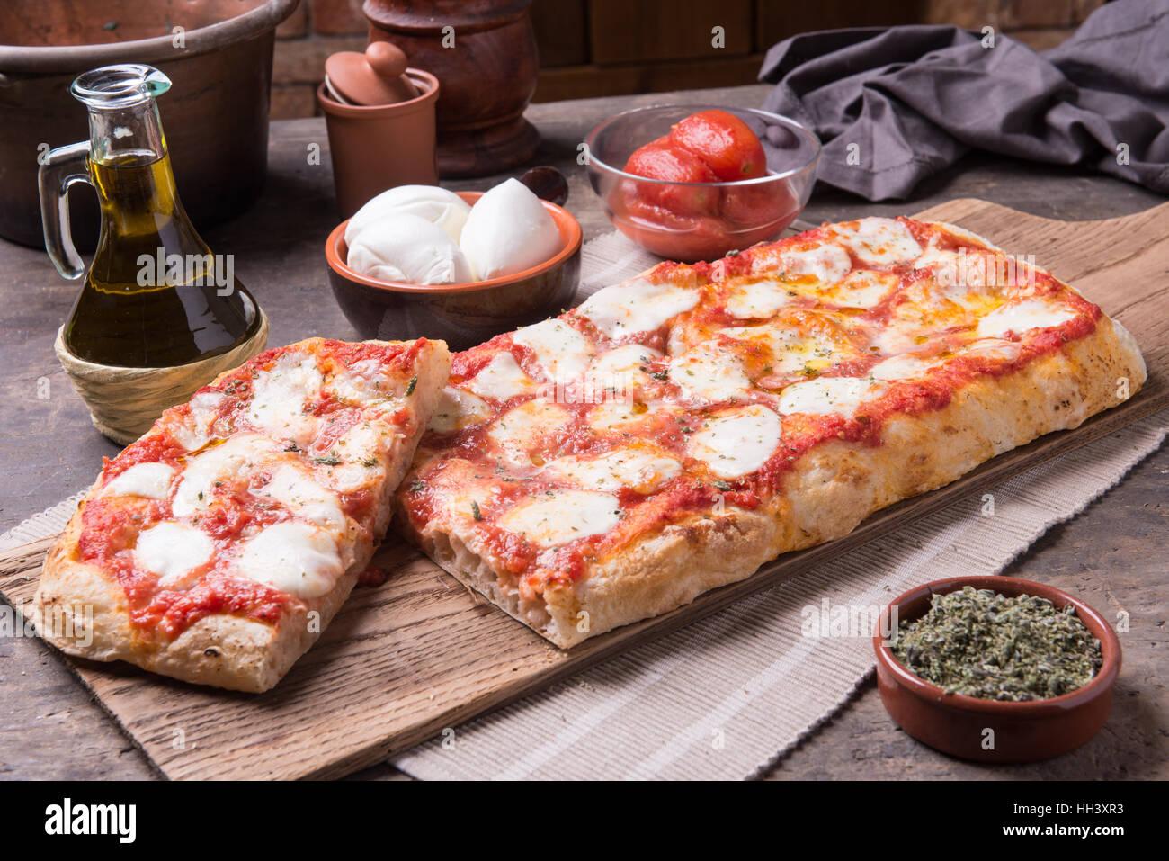 Rectangular shape and thick hand made romana's pizza - Stock Image