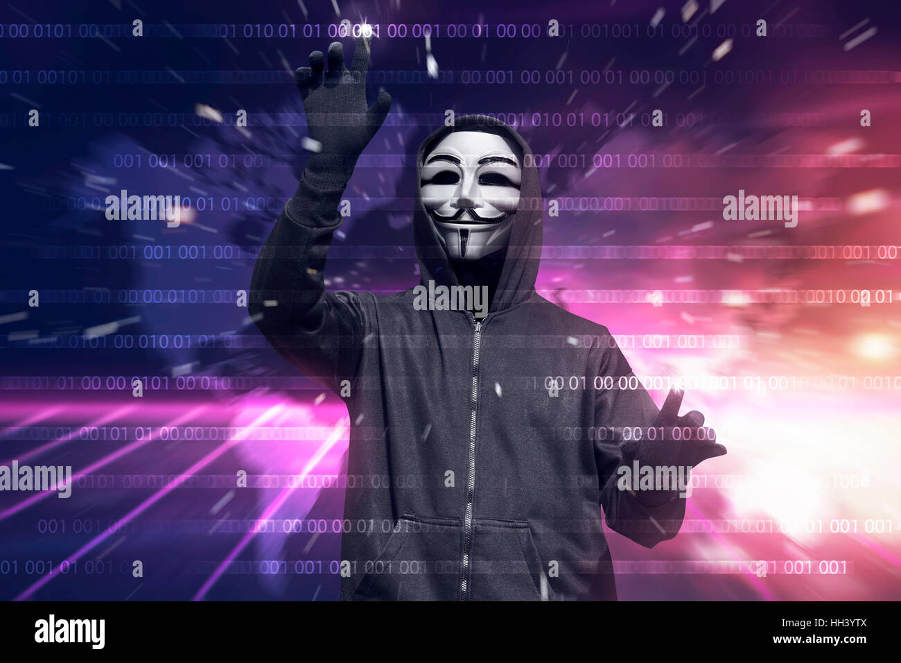 Hooded hacker with mask hacking binary system security code on the virtual screen - Stock Image