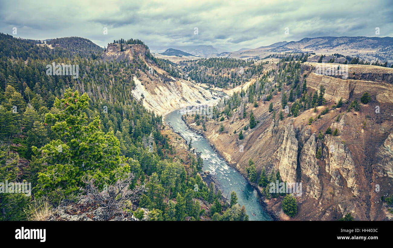 Color toned canyon in Yellowstone National Park on rainy day, Wyoming, USA. - Stock Image