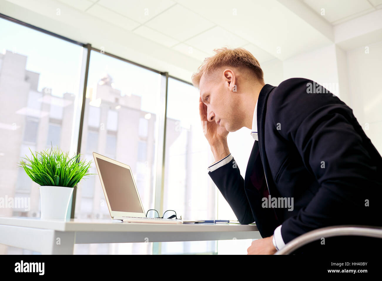 The concept stress, problems in business. Blond businesswoman ho - Stock Image