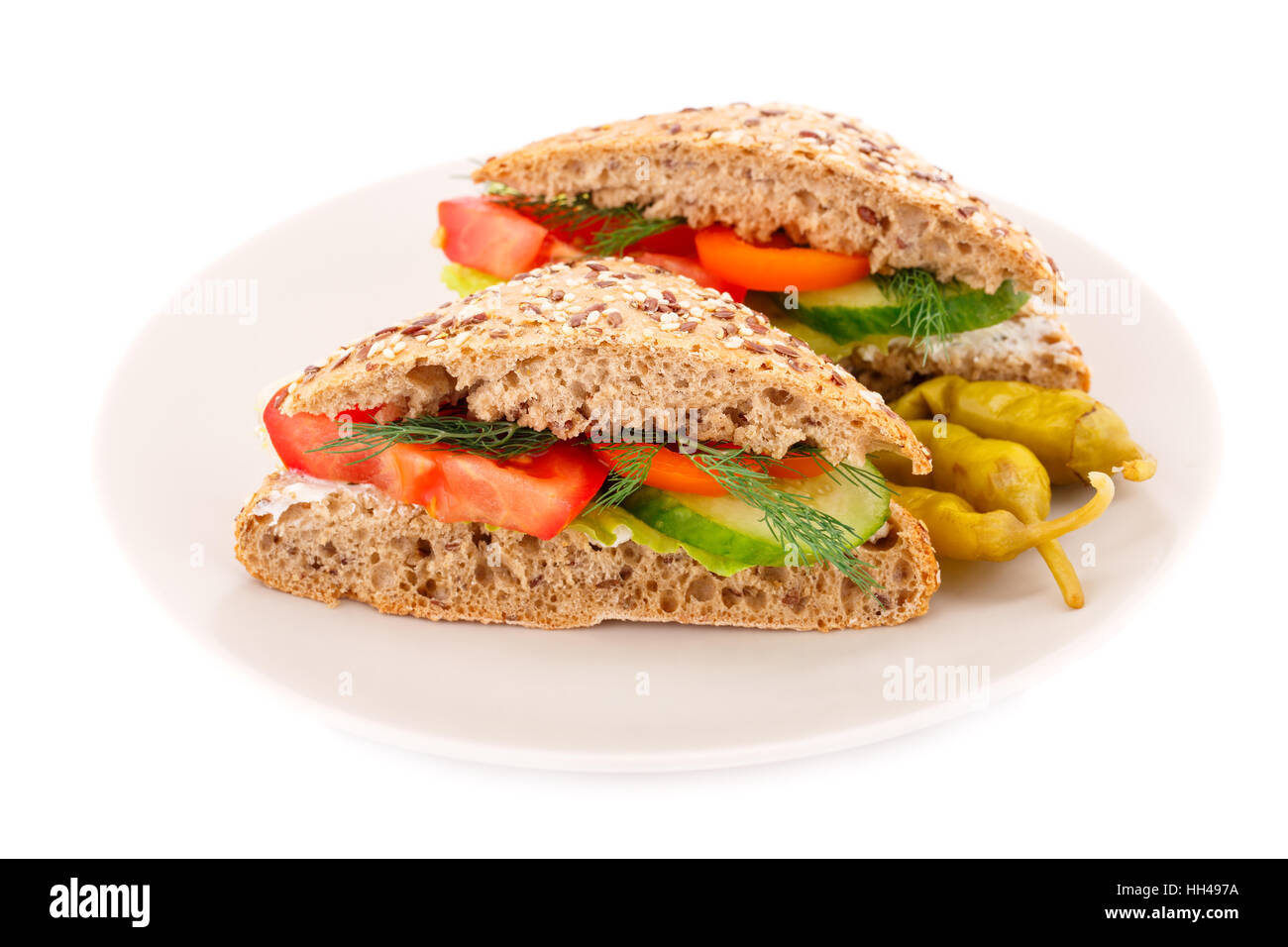 Sandwiches with fresh vegetables and cheese on plate. - Stock Image