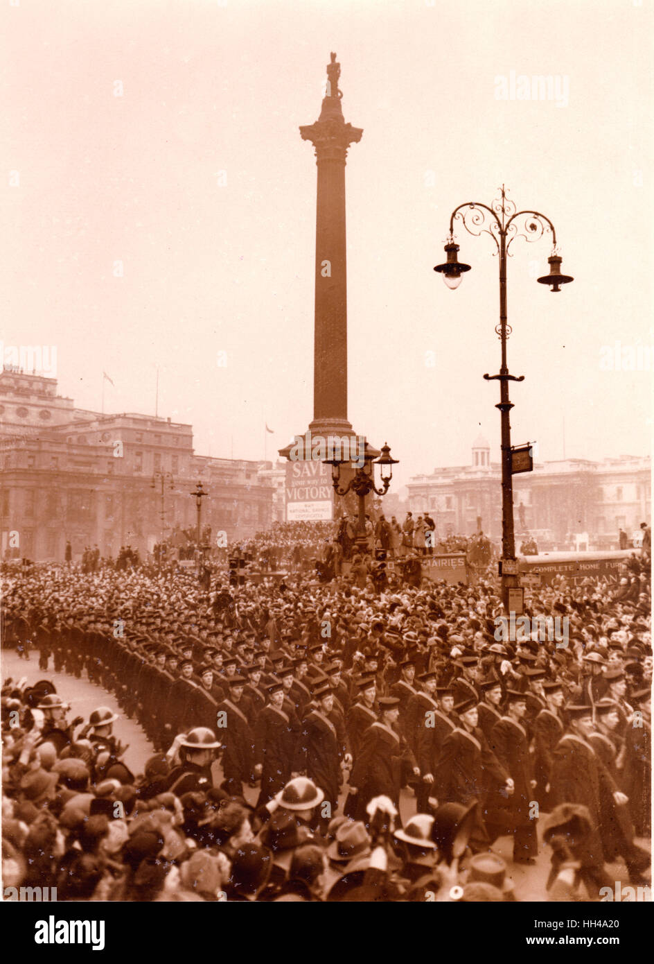 Graf Spee victory parade passes Nelsons Column. Trafalgar Square.23.2.1940 Officer and crew of HMS Exeter  HMS Ajax Stock Photo