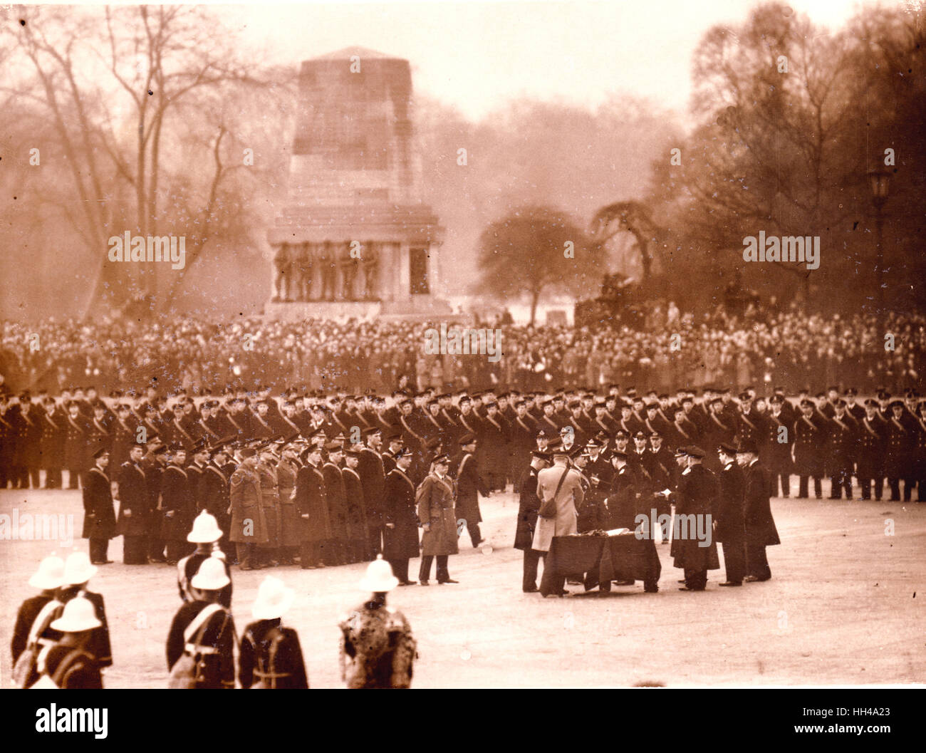 King George VI decorates and hands out medals to the crew of HMS Exeter, Ajax and Achilles on Horse Guards Parade. - Stock Image