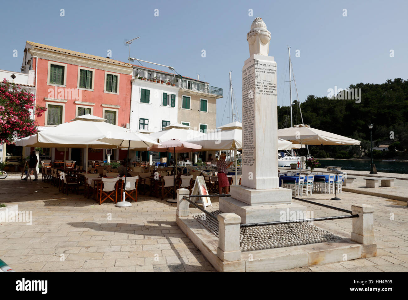 Cafes and restaurants in main square of Gaios town, Paxos, Ionian Islands, Greek Islands, Greece, Europe - Stock Image