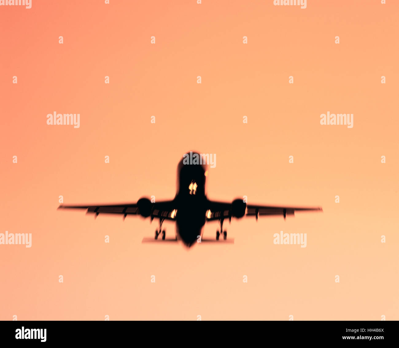 Commercial airliner on final approach to runway, London, England, UK - Stock Image