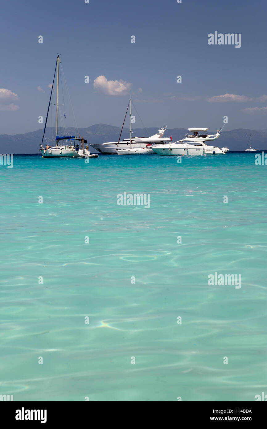 Turquoise sea and yachts anchored off Voutoumi beach, Antipaxos, Ionian Islands, Greek Islands, Greece, Europe - Stock Image