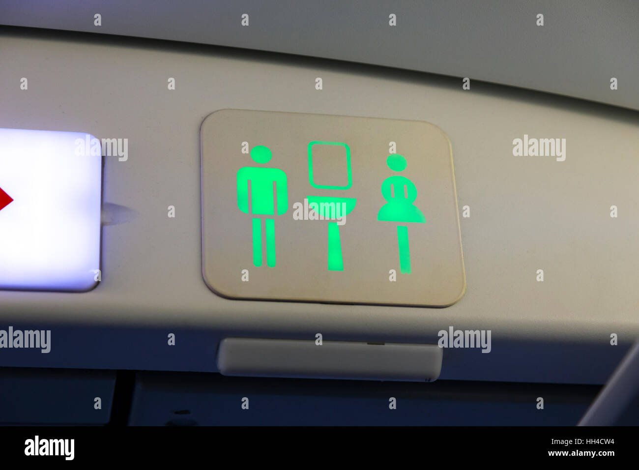 Toilet toilets sign / lavatory / loo / WC / ladies / gents / logo signs on an Airbus A320 airplane Air plane aeroplane - Stock Image