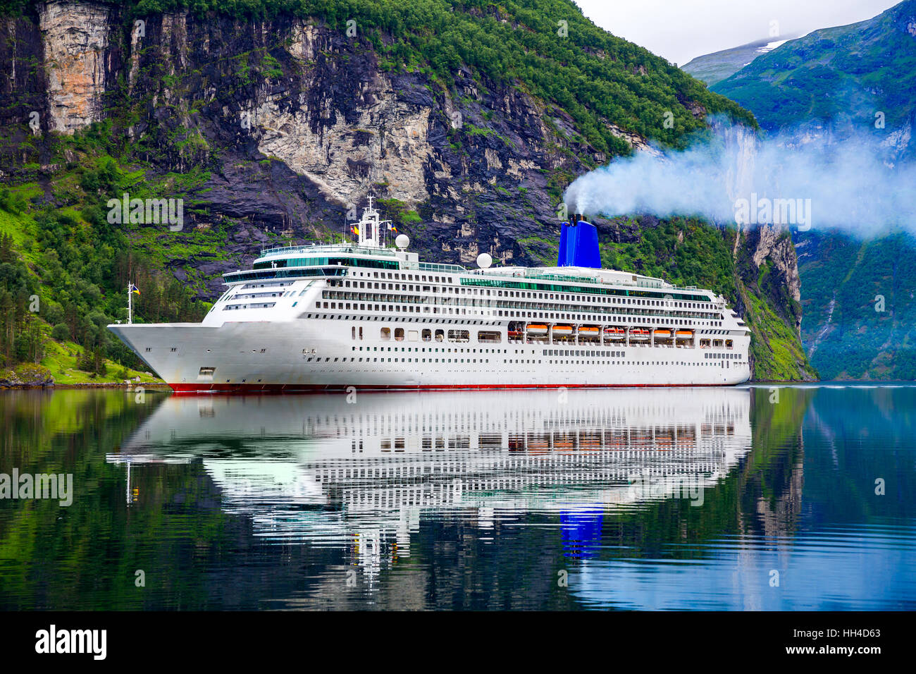 Cruise Ship, Cruise Liners On Geiranger fjord, Norway - Stock Image