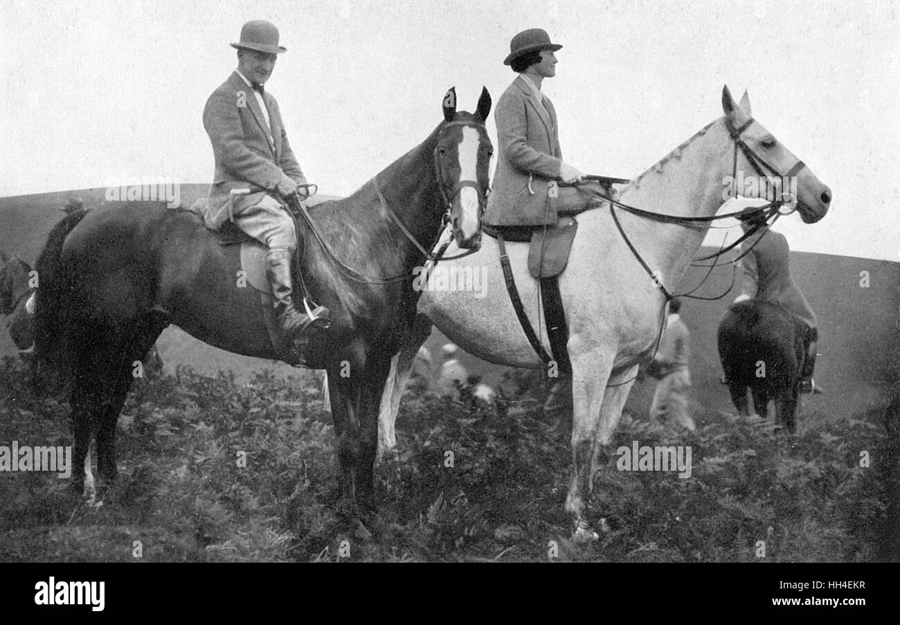Cecil Aldin (1870-1935), British artist and illustrator, seen here on horseback with Mrs A J Munnings (Munnings' - Stock Image