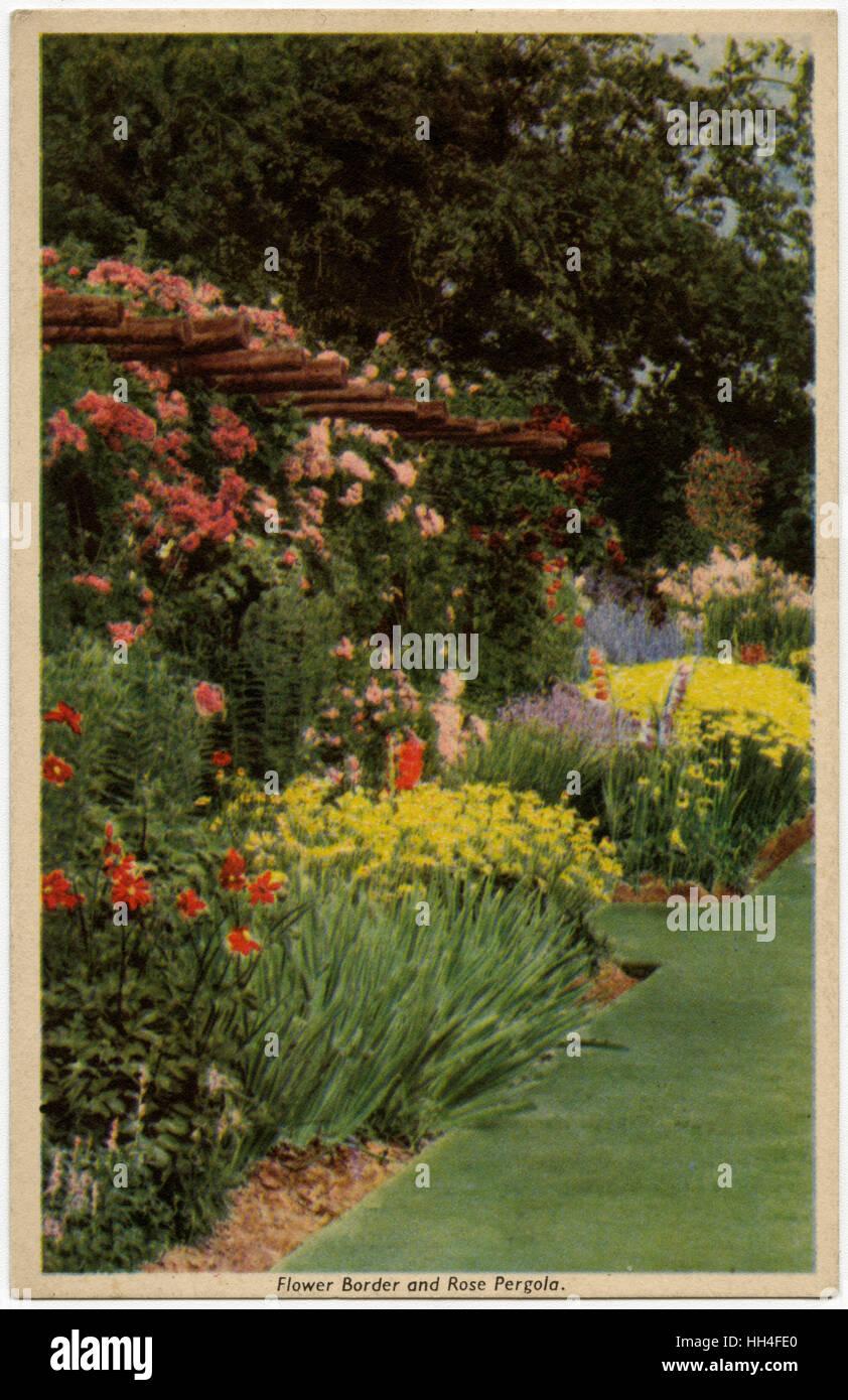 Floral Border and Rose Pergola - Popular 1930s garden scheme/layout/design. Stock Photo