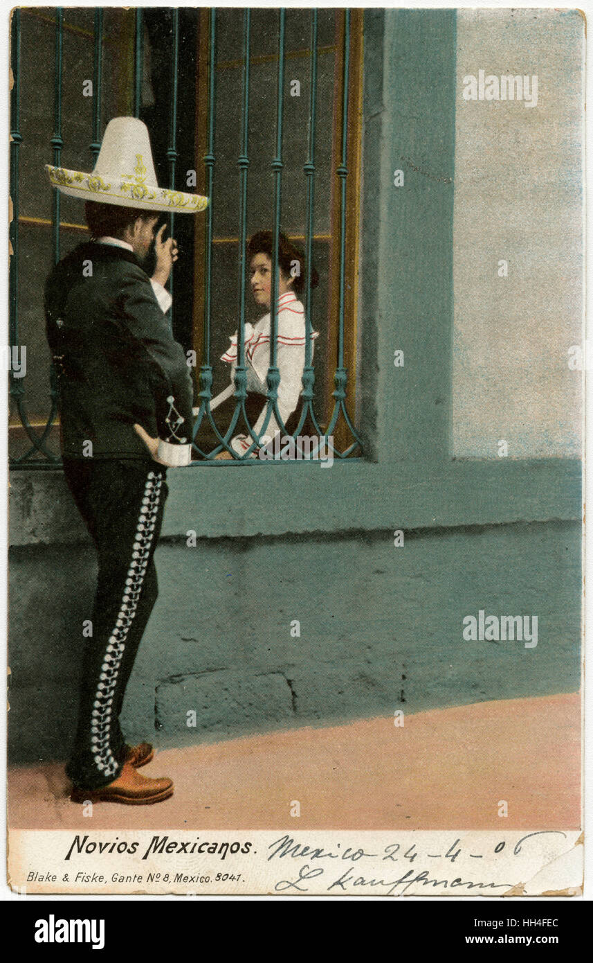Mexican dating ('Novios Mexicanos') - A pair of lovers chat through a barred window - it doesn't look - Stock Image