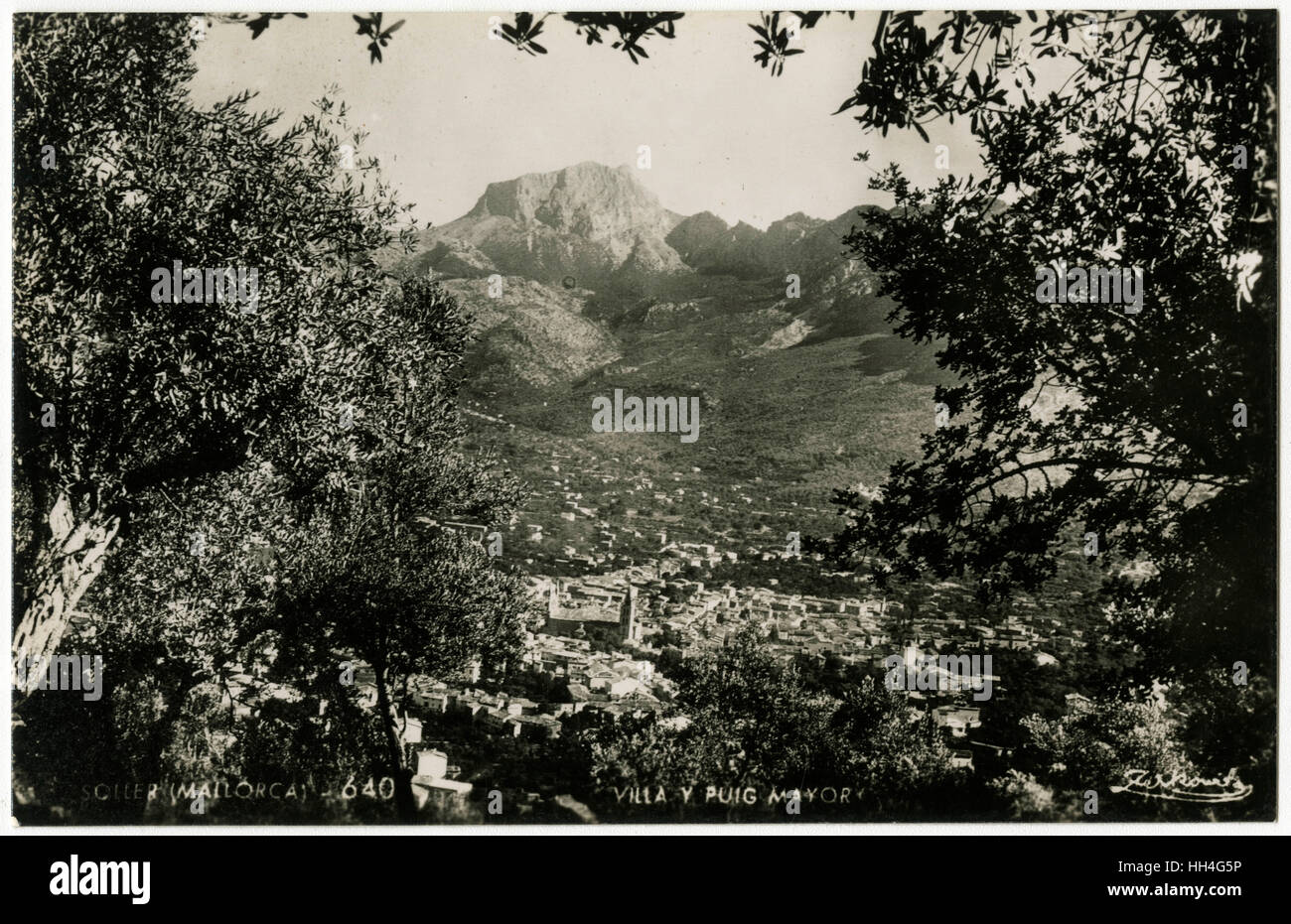 View down to the town of Soller and up to the distant form of the Puig Major, the highest peak on the Spanish island - Stock Image