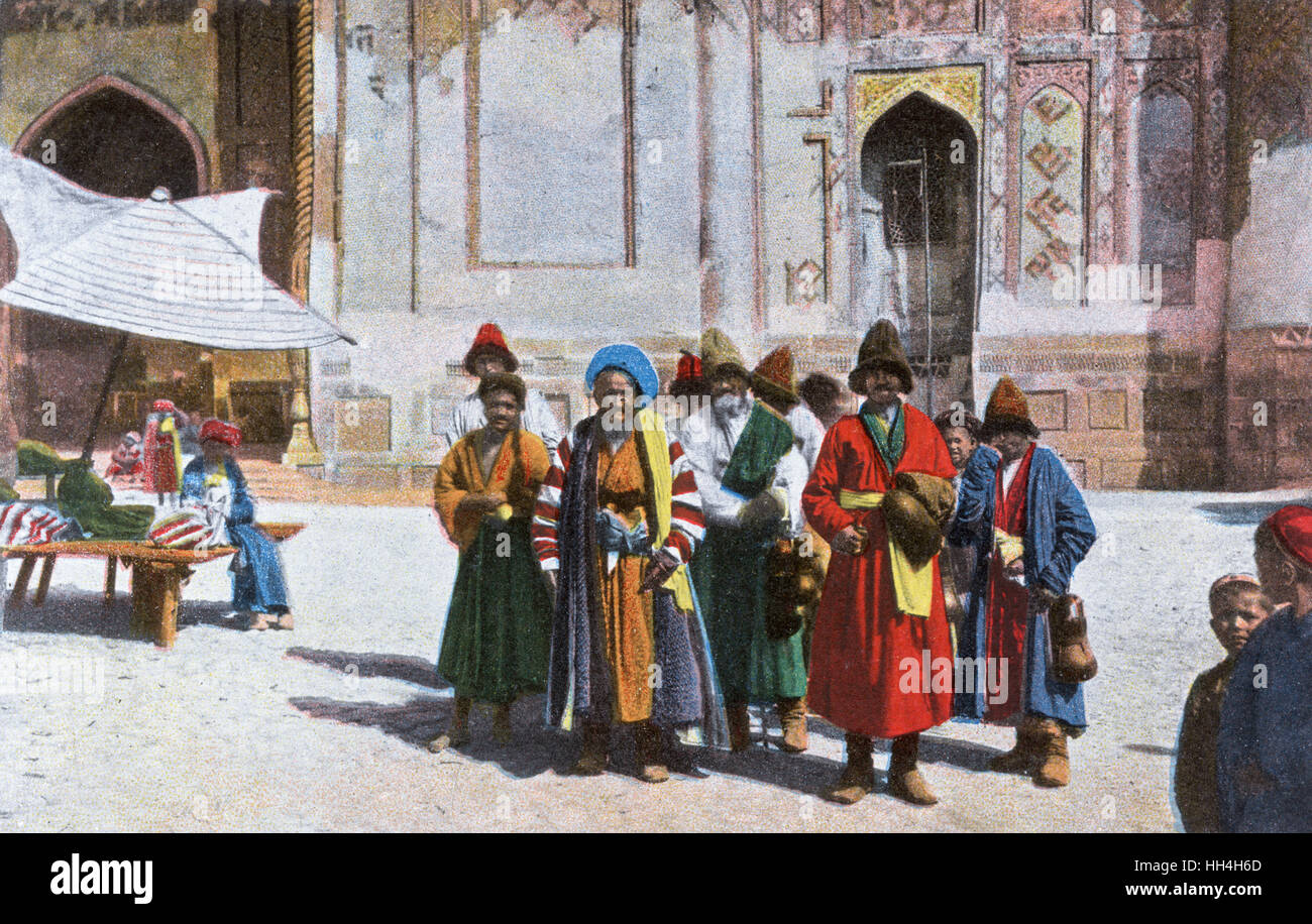 Wandering Uzbek dervishes at Samarkand, Uzbekistan - Scene in the Registan. The Registan was a public square, where - Stock Image