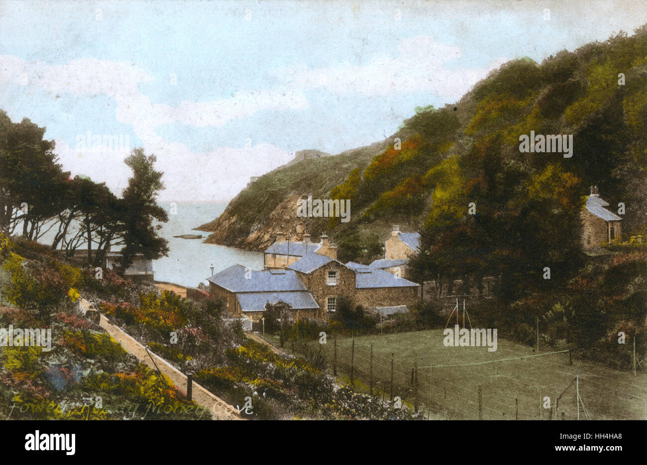Ready Money Cove, Fowey, south-east Cornwall, with a tennis court in the foreground. - Stock Image