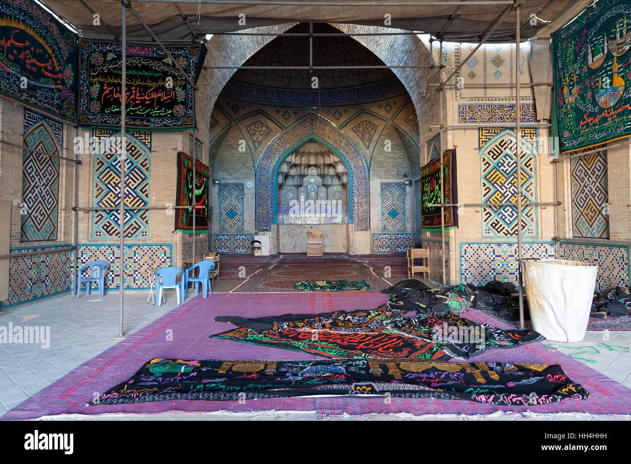 Carpets inside Hakim mosque, Isfahan, Iran - Stock Image