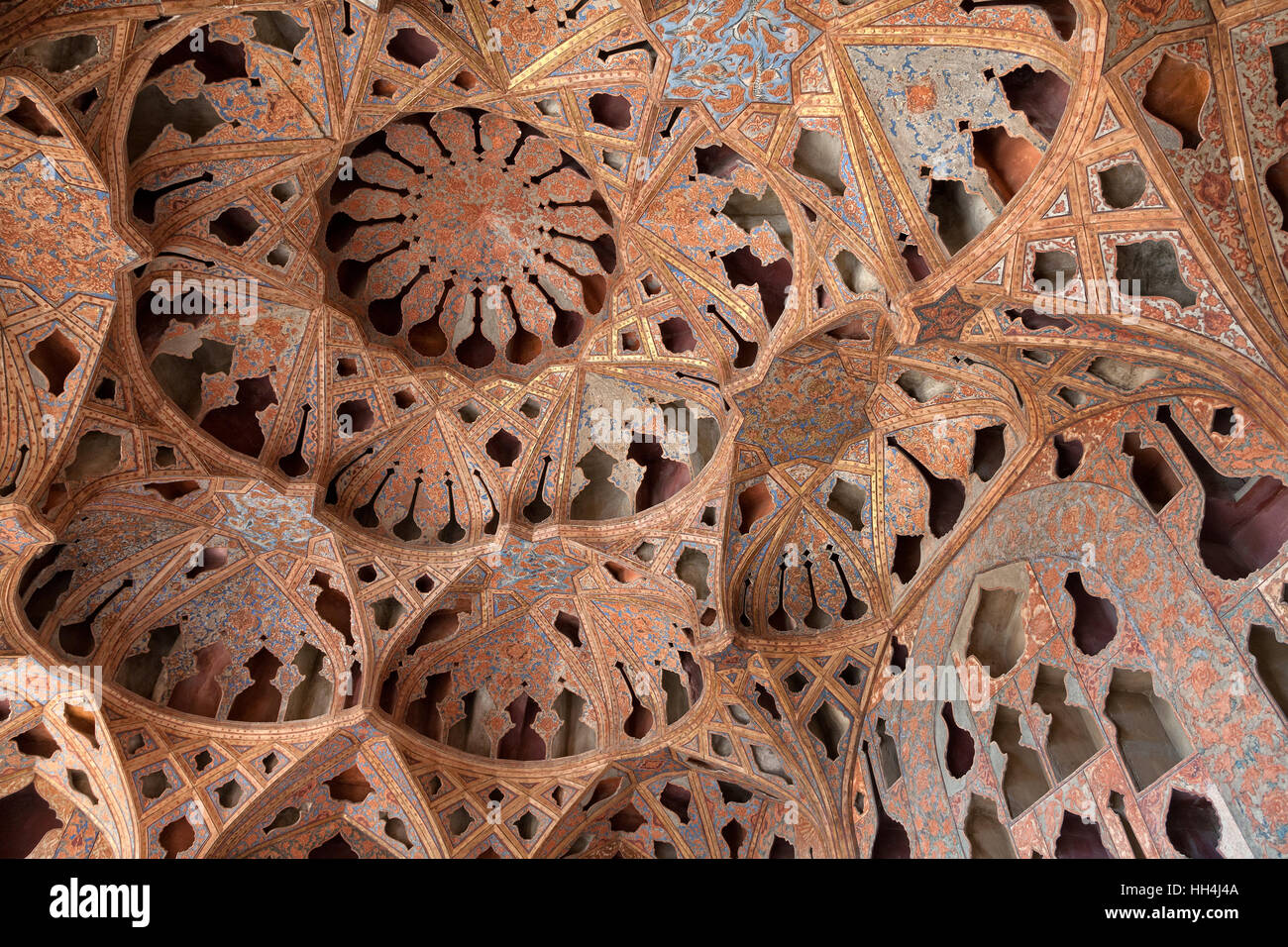 Patterned ceiling with shapes of music instruments in Ali Qapu Palace, Esfahan, Iran Stock Photo