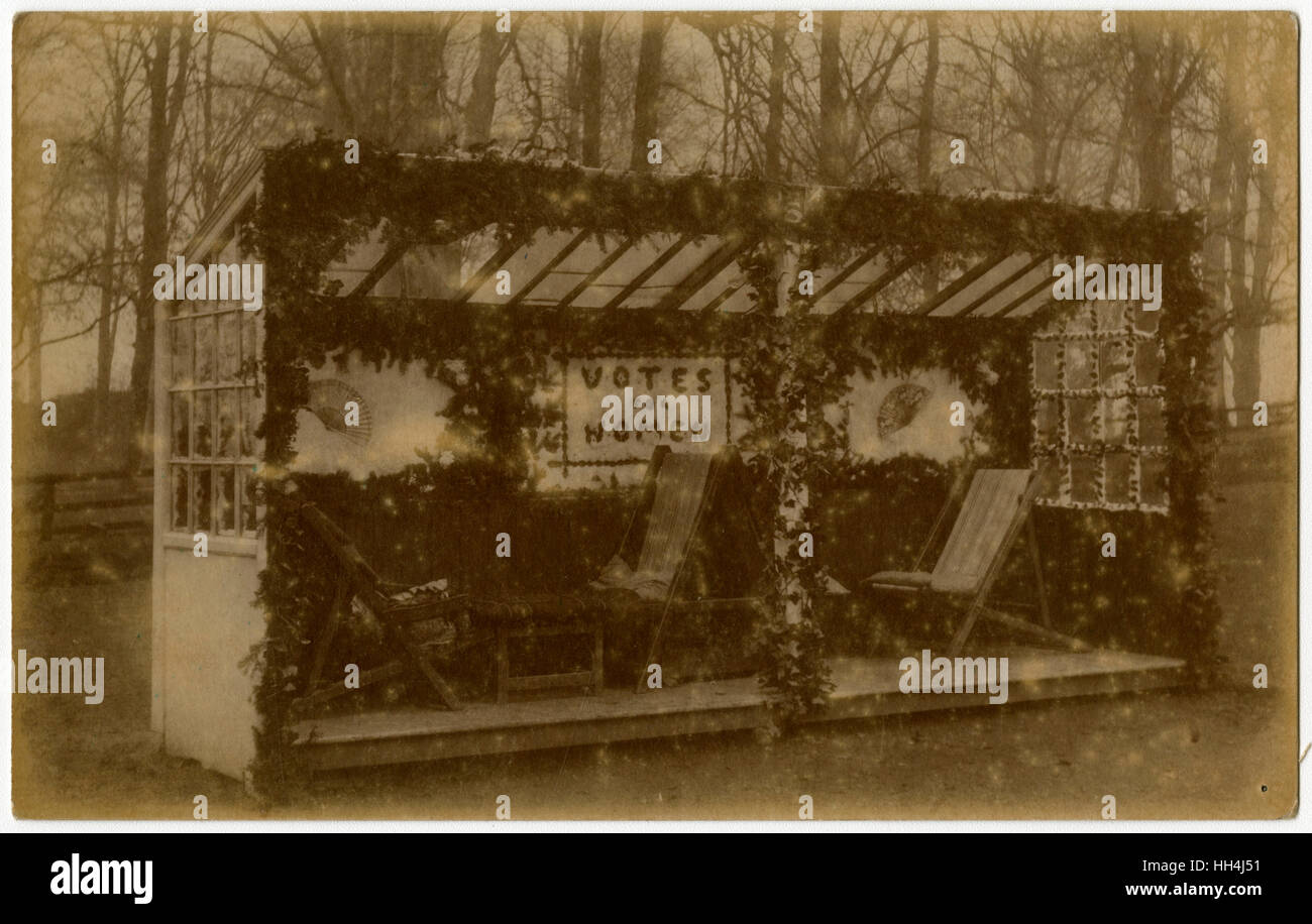 An outdoor bed/deckchair shelter, decorated in support of the Campaign for Women's Suffrage (Votes for Women) - Stock Image