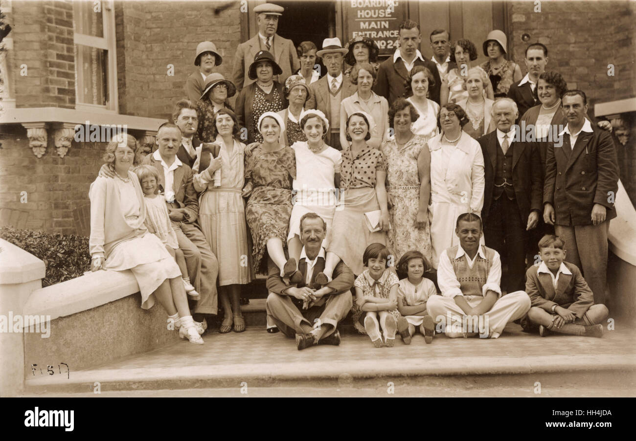 Delightful group photograph of assorted guests at an unidentified boarding house at the seaside resort of Margate Stock Photo