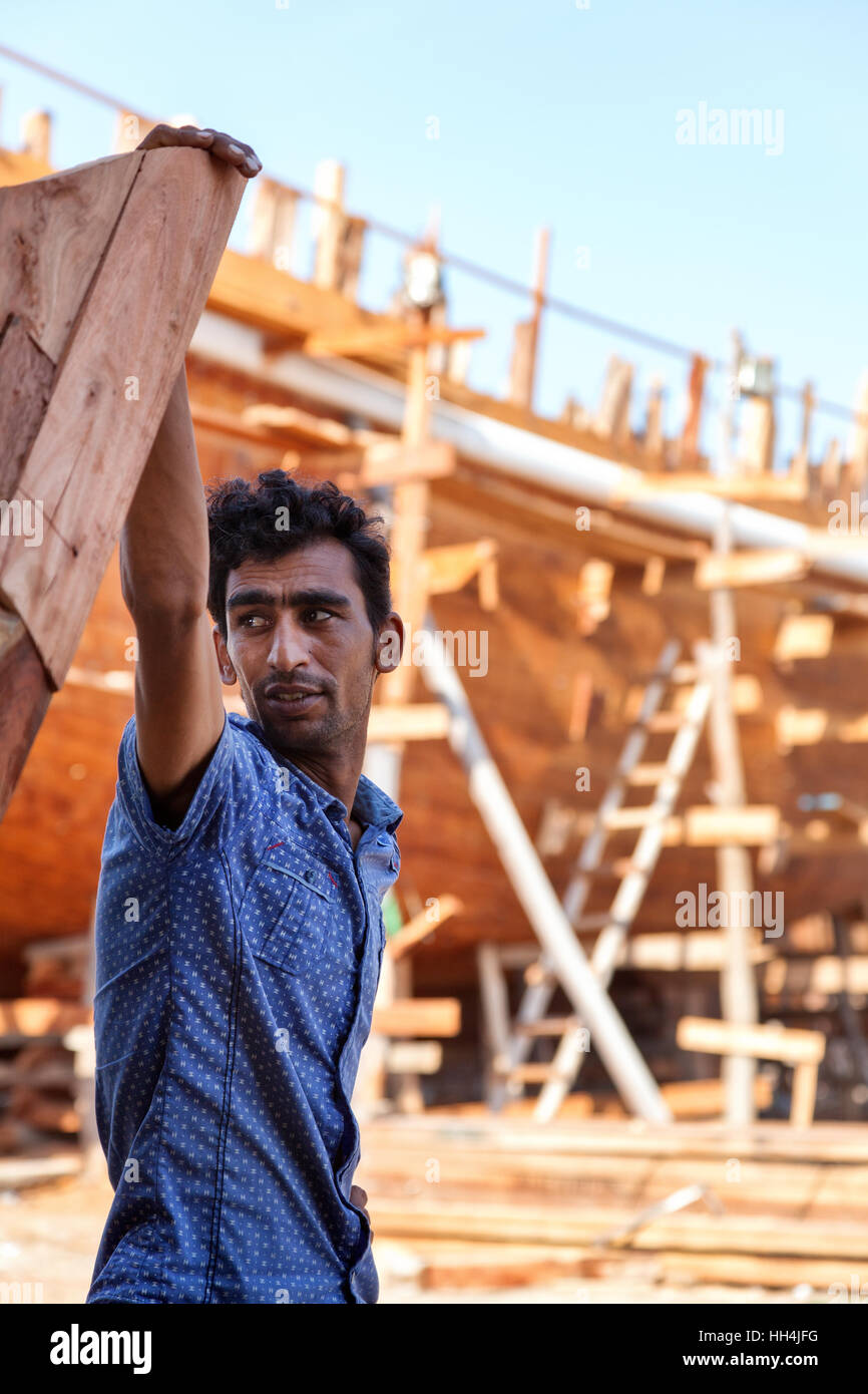 Qeshm, Iran - October 22, 2015 : Shipyard worker portrait. Traditional wooden cargo vessels are still built in Qeshm - Stock Image