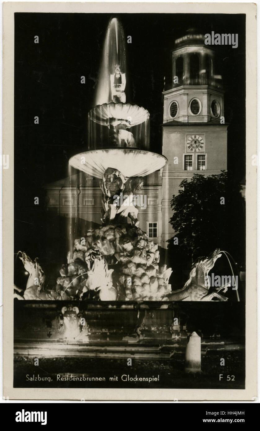 Residenzplatz with Residenzbrunnen (fountain) in Salzburg. Taken at Night, showing the illuminations. - Stock Image