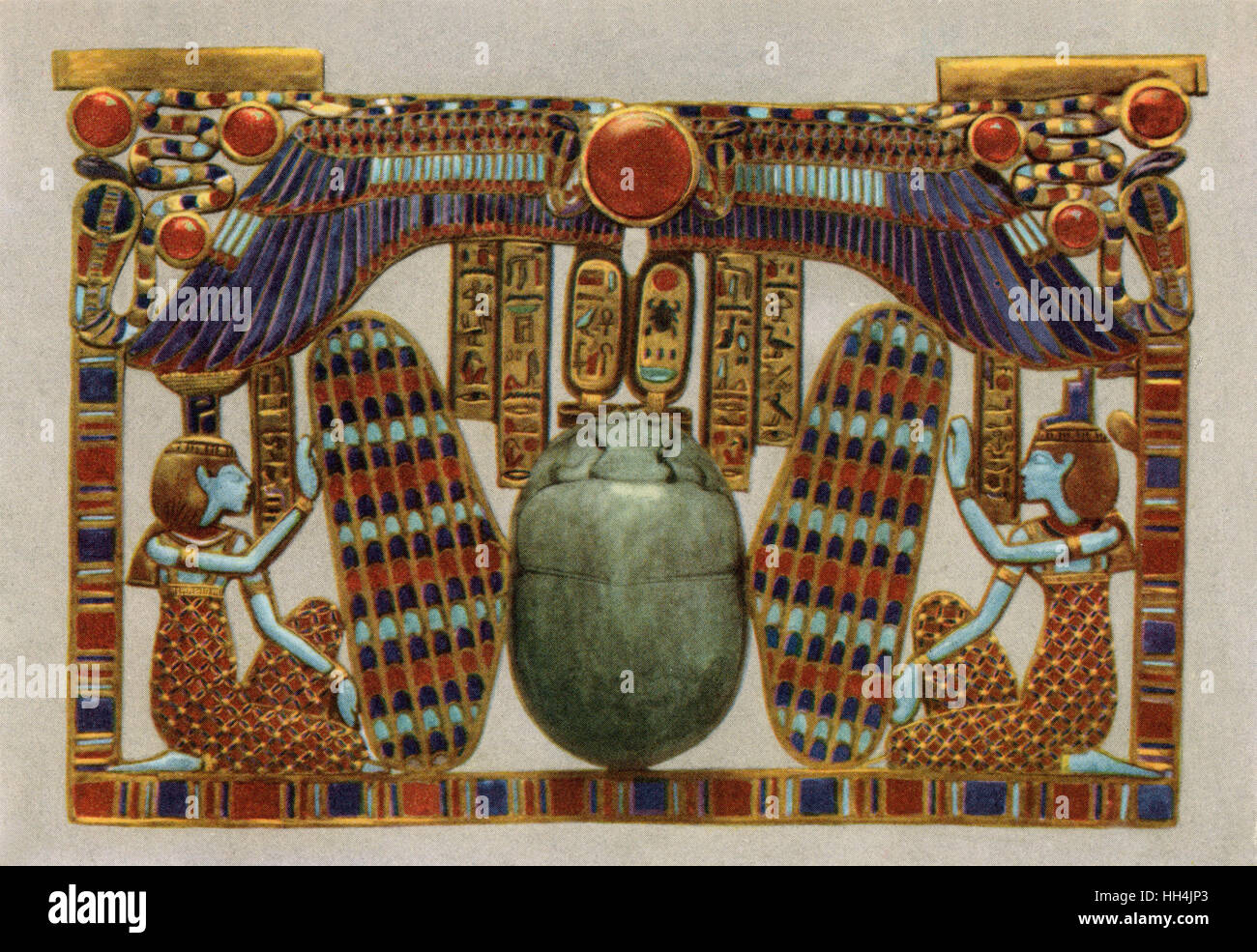 A pectoral from the tomb of Pharao Tutankhamun (reigned 1332–1323 BC). It  is composed of a winged scarab, flanked - Stock Image