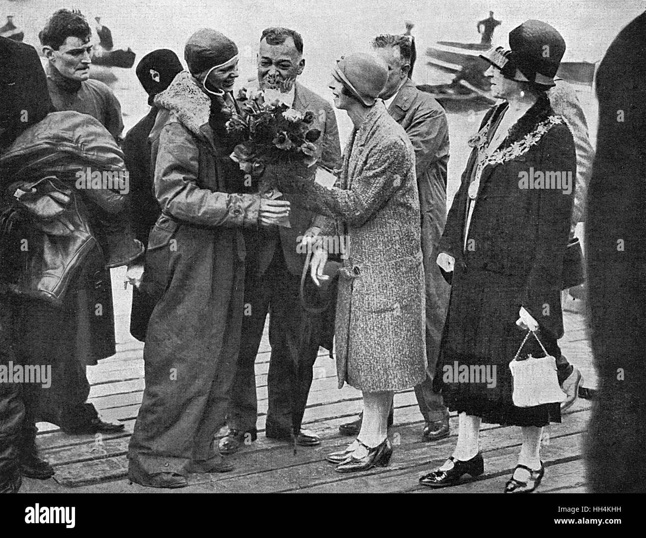 Amelia Earhart is greeted by local dignitaries at Southampton on June 18th, 1928 following her flight across the - Stock Image
