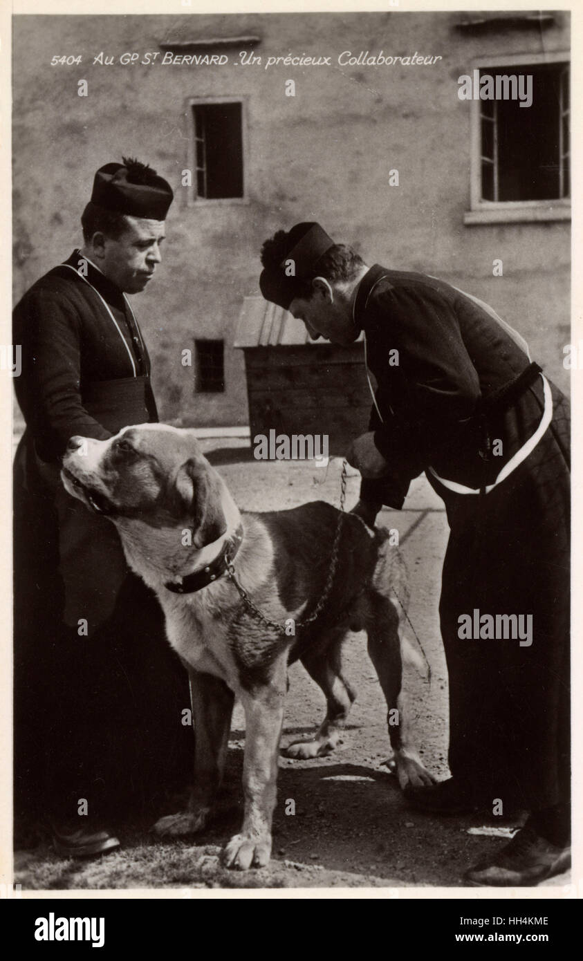 a st bernard dog with two priests switzerland the earliest stock