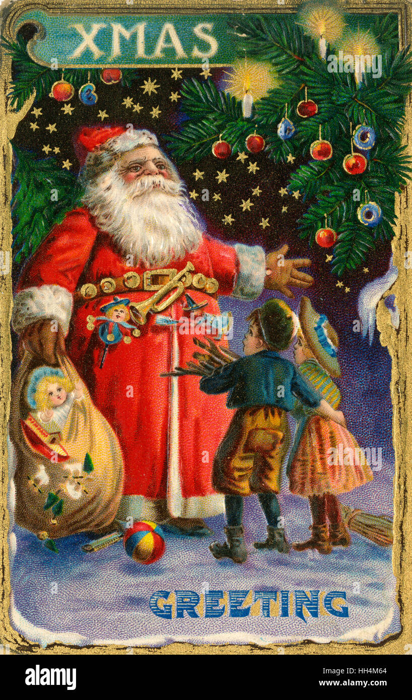Christmas Greeting postcard - Father Christmas greets two poor young children (gathering firewood) his sack bulging with toys. Stock Photo