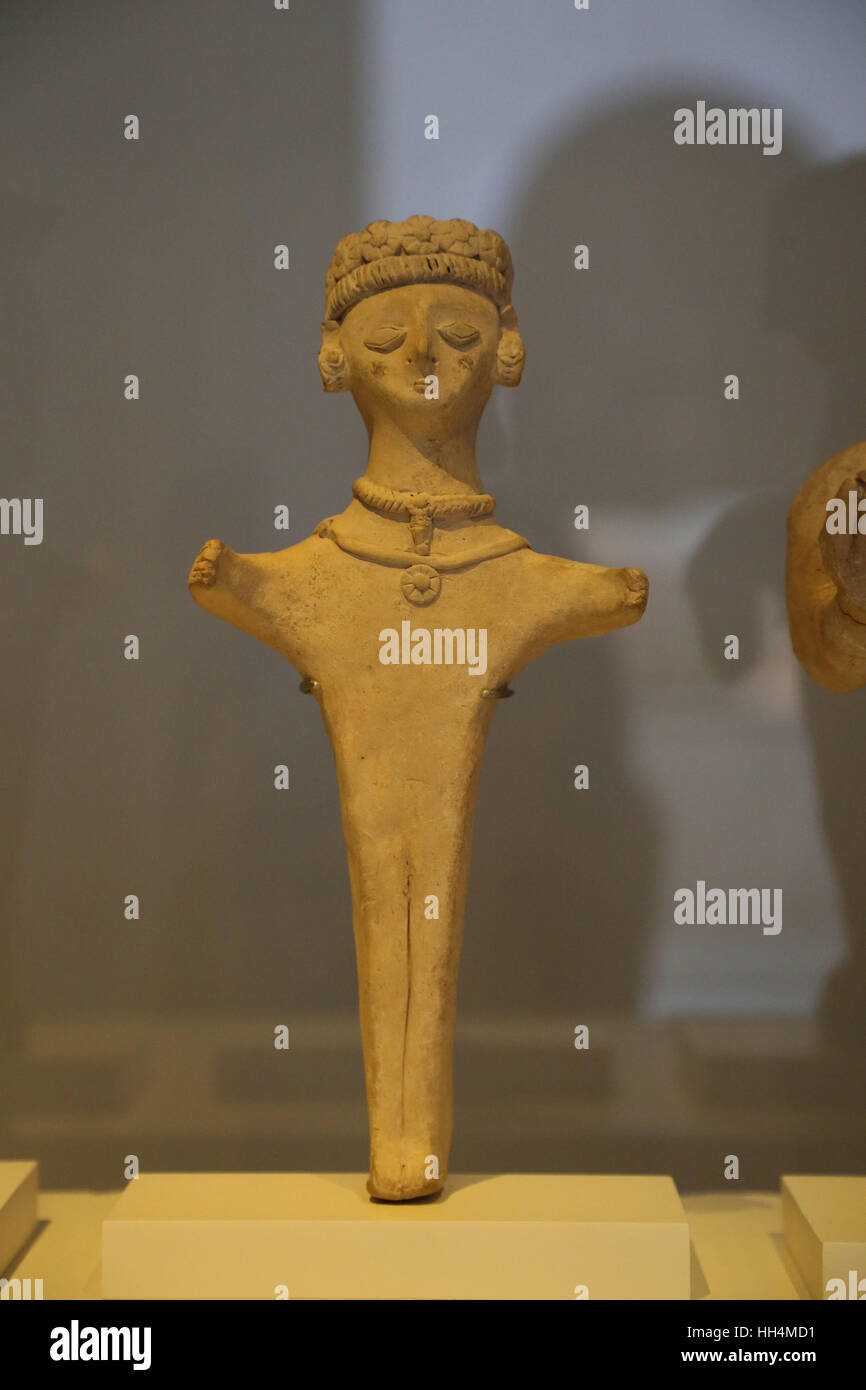 Figure. Deity, a cult figure or an orant. Clay. 4th-3rd century BC. Necropolis of Puig des Molins, Ibiza, Spain. - Stock Image