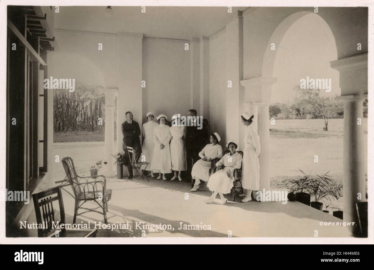 Nuttall Memorial Hospital, Kingston, Jamaica, West Indies, with six nurses and two men on a terrace. Stock Photo