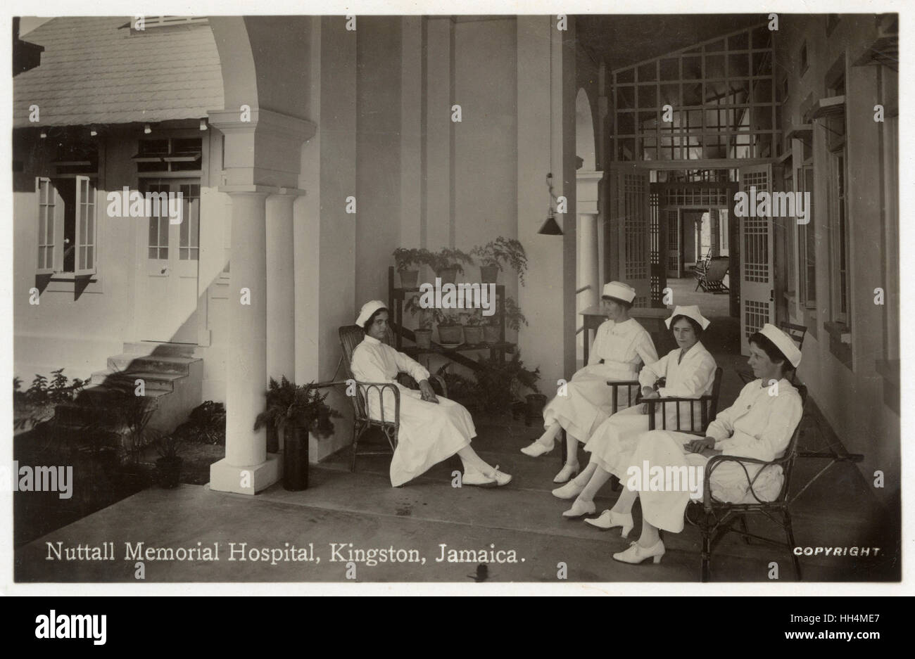 Nuttall Memorial Hospital, Kingston, Jamaica, West Indies, with four nurses seated on a terrace. Stock Photo