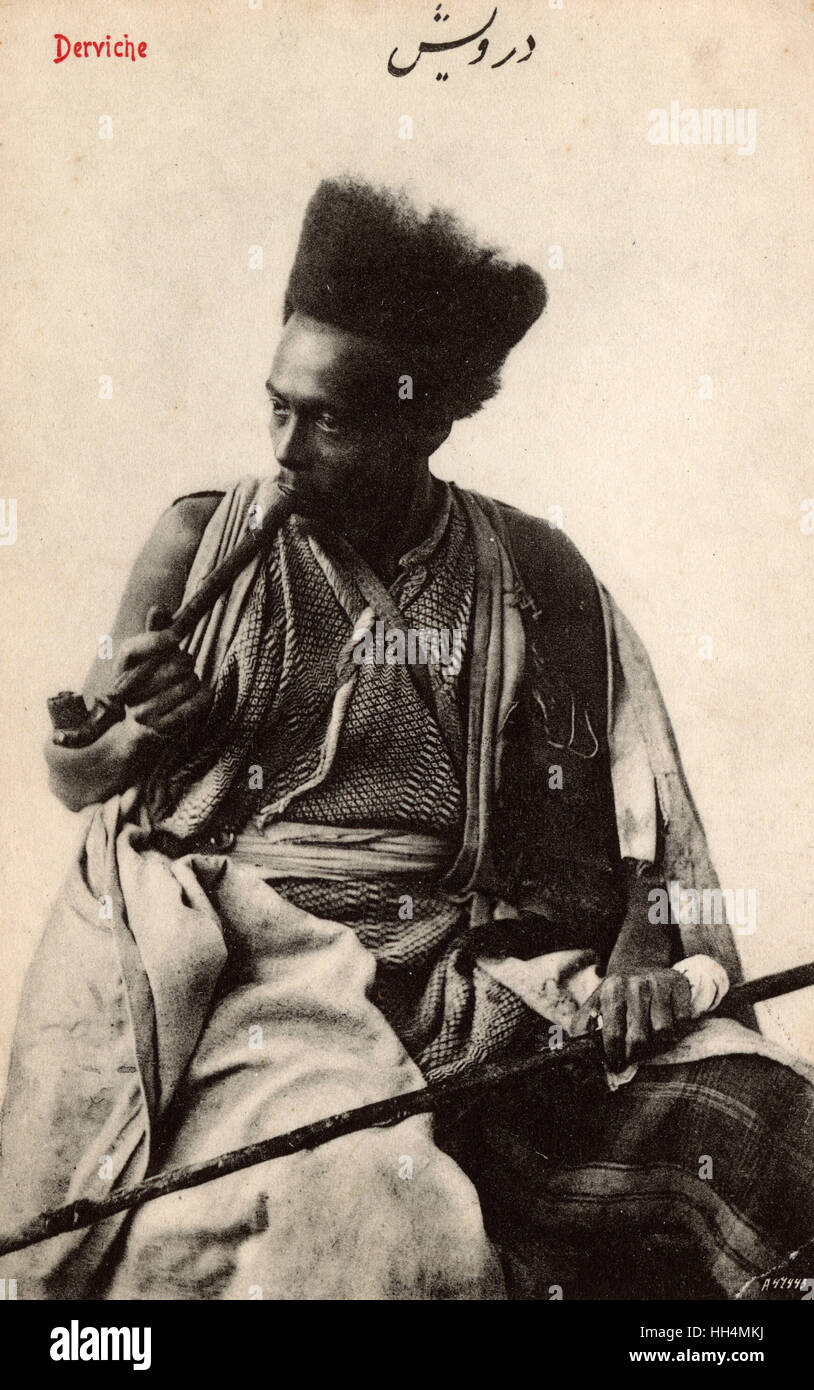 Pipe-smoking Syrian Dervish with fantastic hairstyle. Dervish or Darvesh in Persian usually refers to a person who - Stock Image