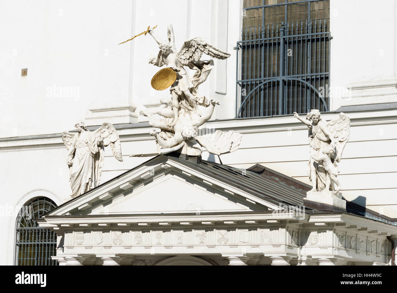 Wien, Vienna: Angelic fall above the entrance of the Church of St. Michael, 01. Old Town, Wien, Austria - Stock Image