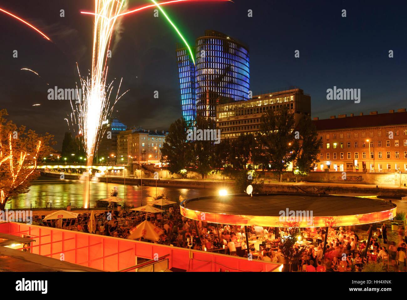 Wien, Vienna: beach bar Herrmann at the Danube canal with Uniqa Tower, fireworks, 03., Wien, Austria - Stock Image