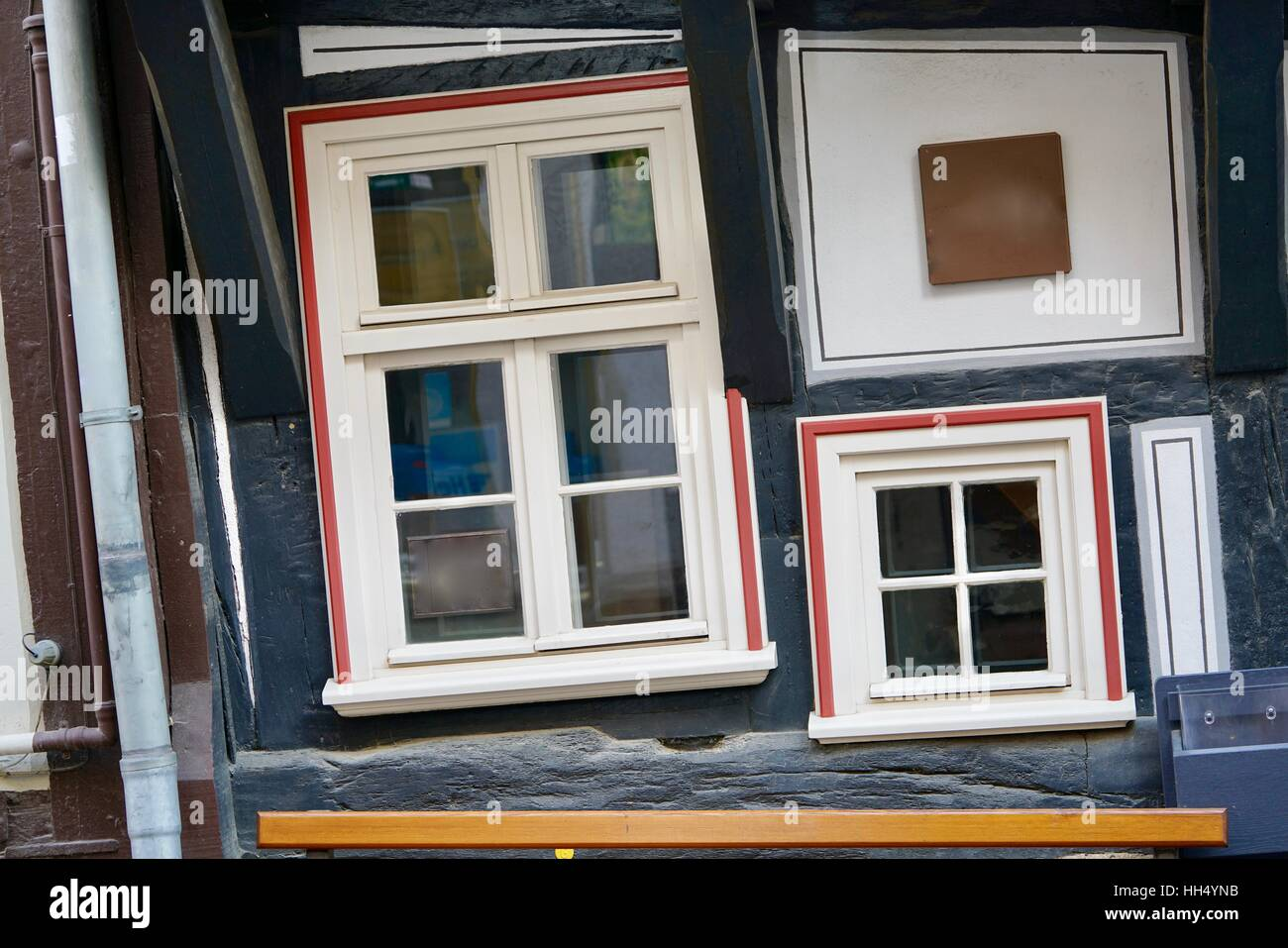 skew windows of an old house in Fritzlar, Germany - Stock Image