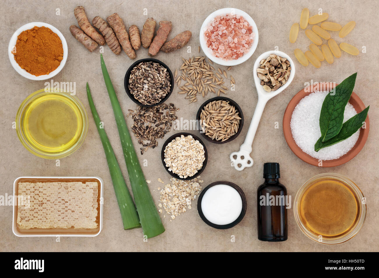 Natural ingredients for skin health care to help heal eczema and psoriasis on hemp paper background. - Stock Image